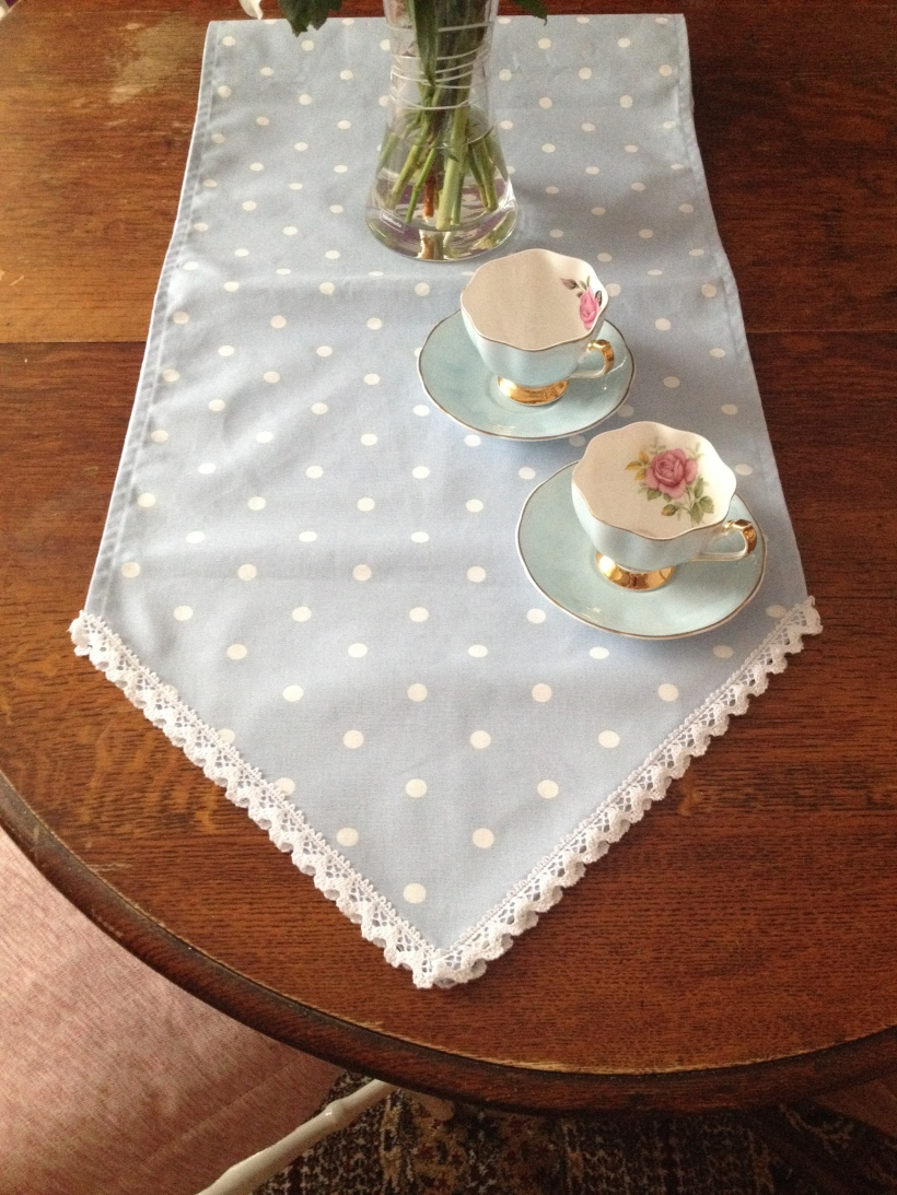 Handmade shabby chic polka dots and lace table runner, perfect for weddings